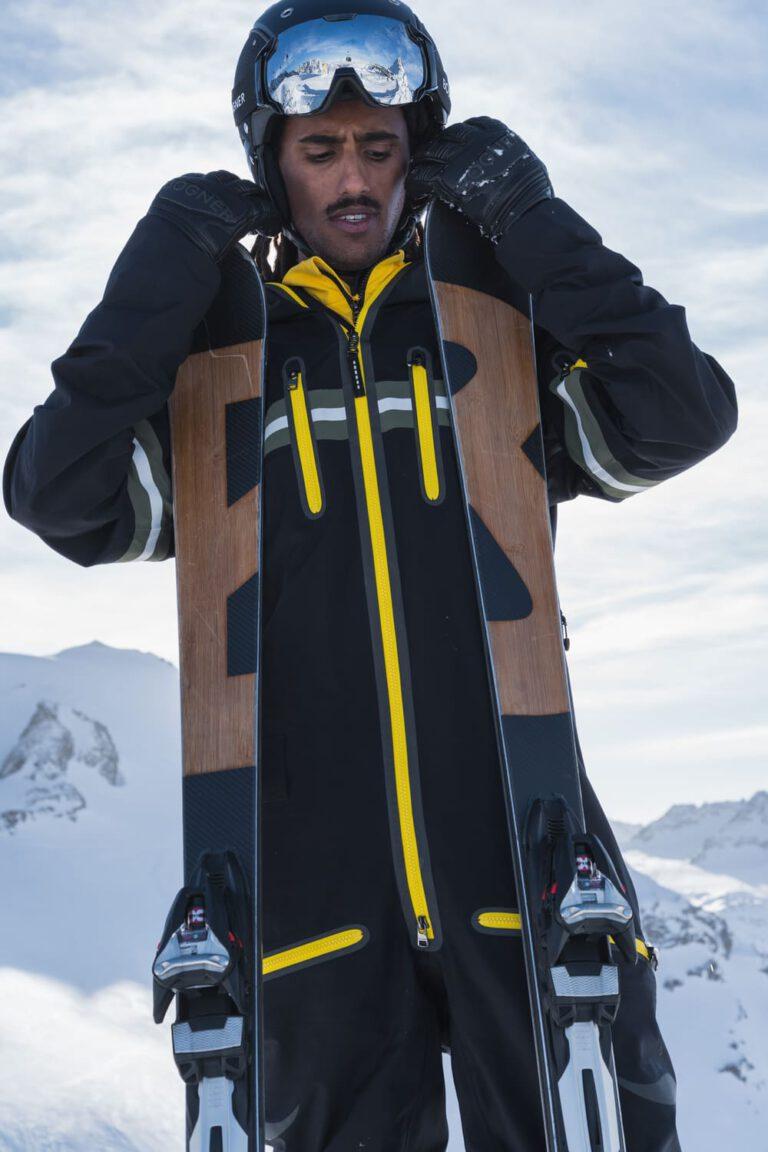 Ein Mann mit Ski - Chris Gollhofer People Fotografie
